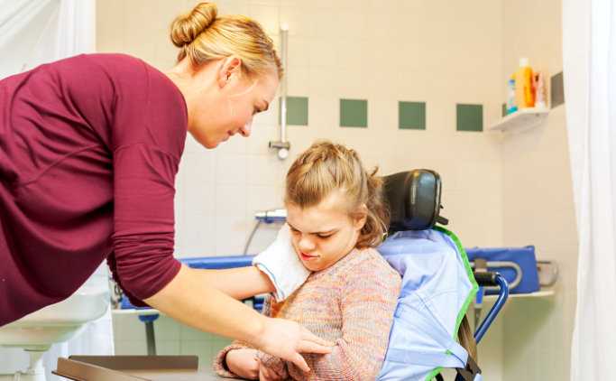 caregiver and taking care of a young woman