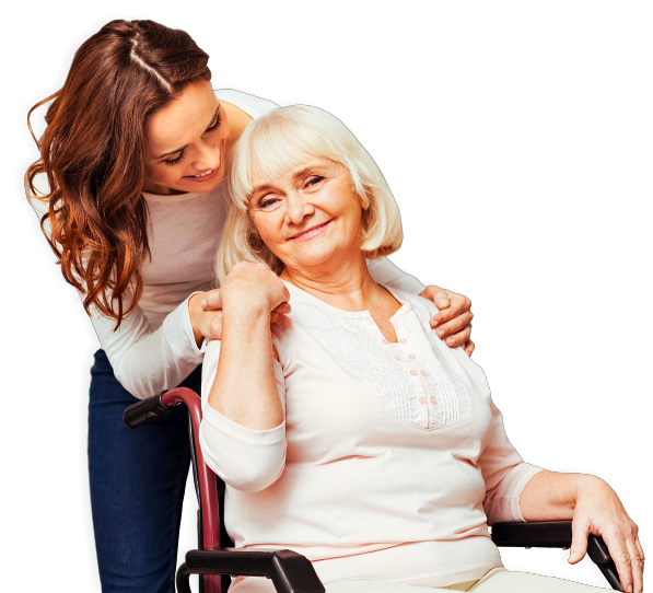 caregiver holding the shoulder of senior woman in wheelchair