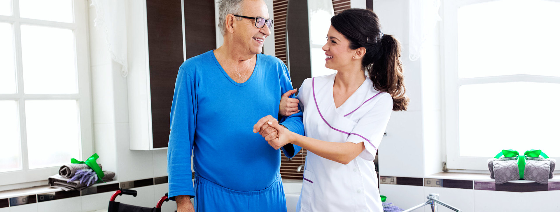caregiver ang senior man smiling
