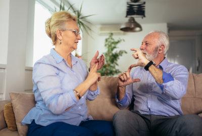 woman teaching a sign language
