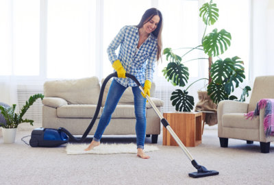 woman vacumming the carpet