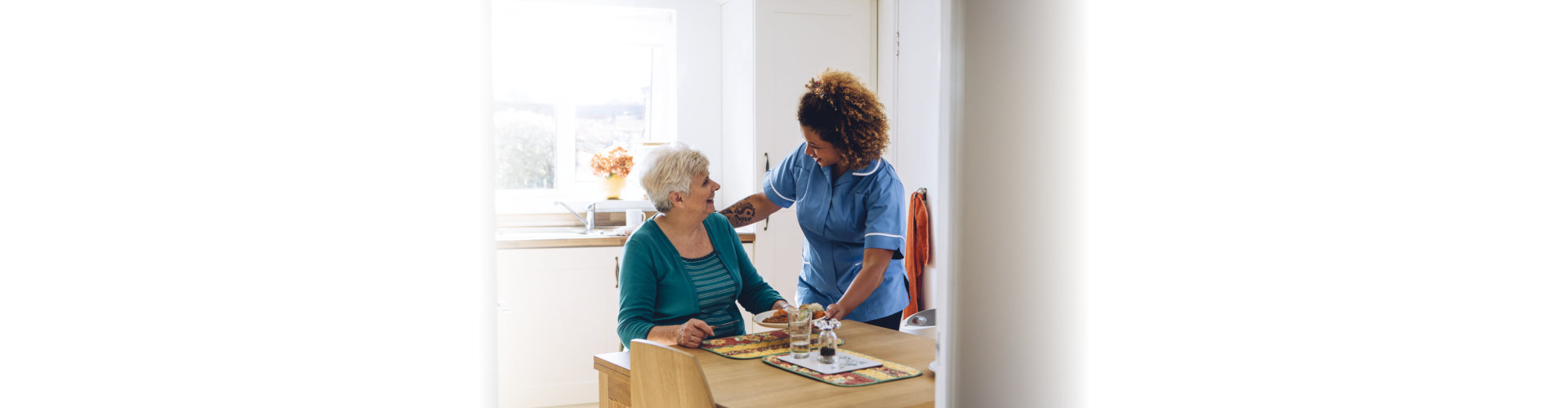 nurse giving food to patient